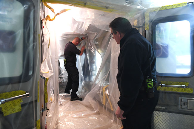 Members of the Pantex Fire Department install a Biocell Ambulance Protective System