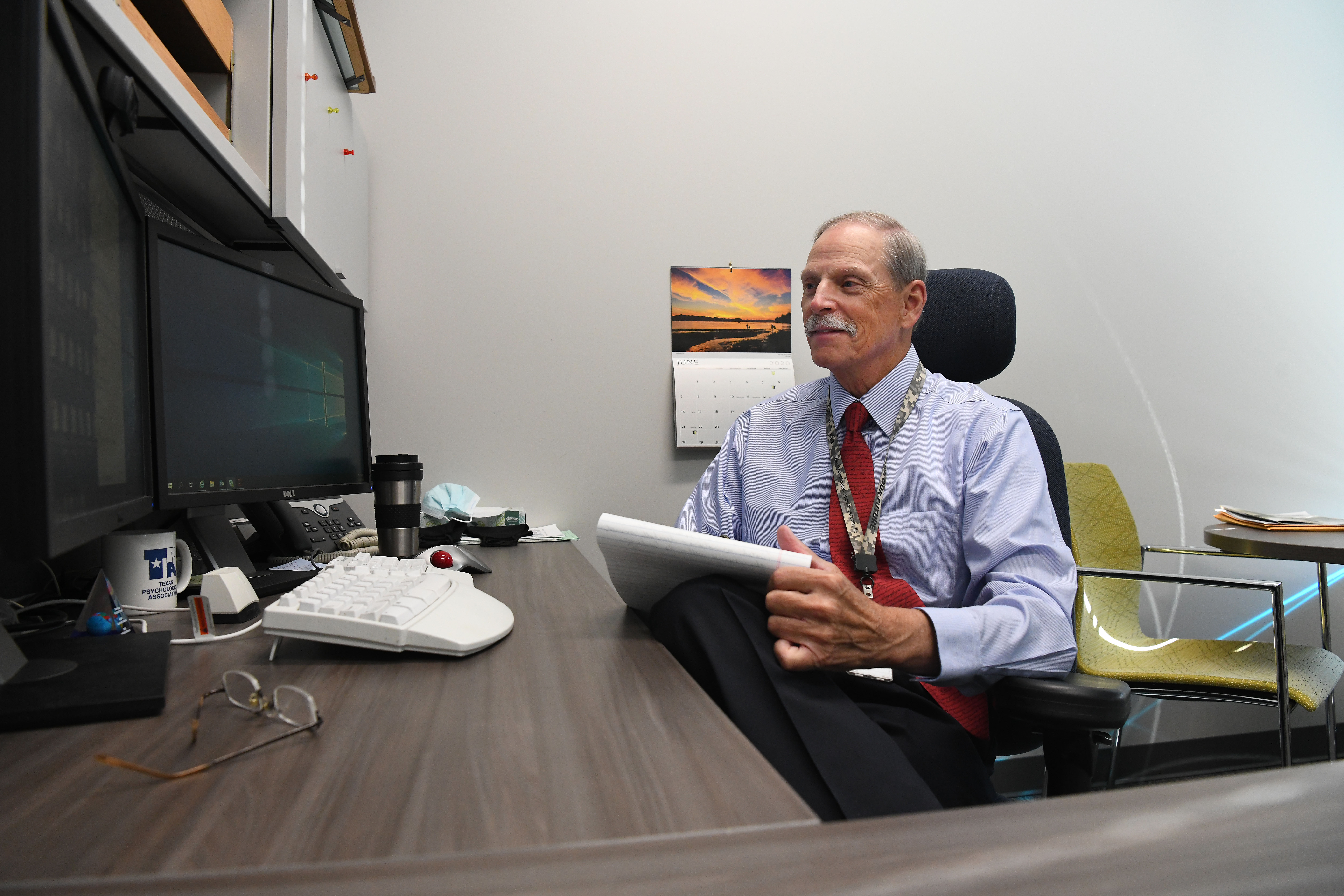 Dr. Mark Izzard conducts a telepsychology session from his office at Pantex.