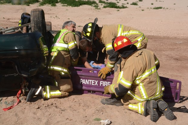 Pantex Fire Department emergency response personnel work to extract a training mannequin