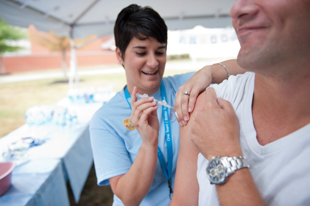 Melissa Davis gives the flu vaccine