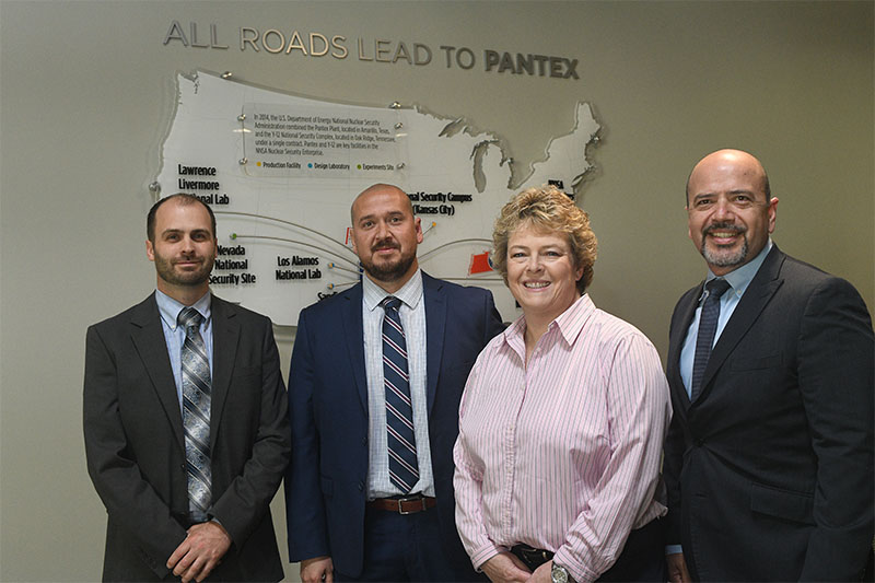 Pantex Small Business Program Manager Ryan Johnston (l), SAM Engineering & Surveying, Inc. President Saul Maldonado, Pantex Supply Chain Manager Kelly Delgado-Goudschaal, and SAMES, Inc. Chief Executive Officer Samuel Maldonado