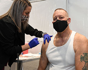 Geoff Beausoleil, manager of the NNSA Production Office, receives his COVID‑19 vaccination.